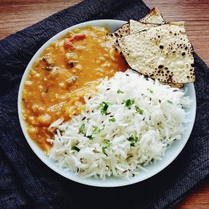 Dal Tadka served with rice and papad, staple meal in South Asia.