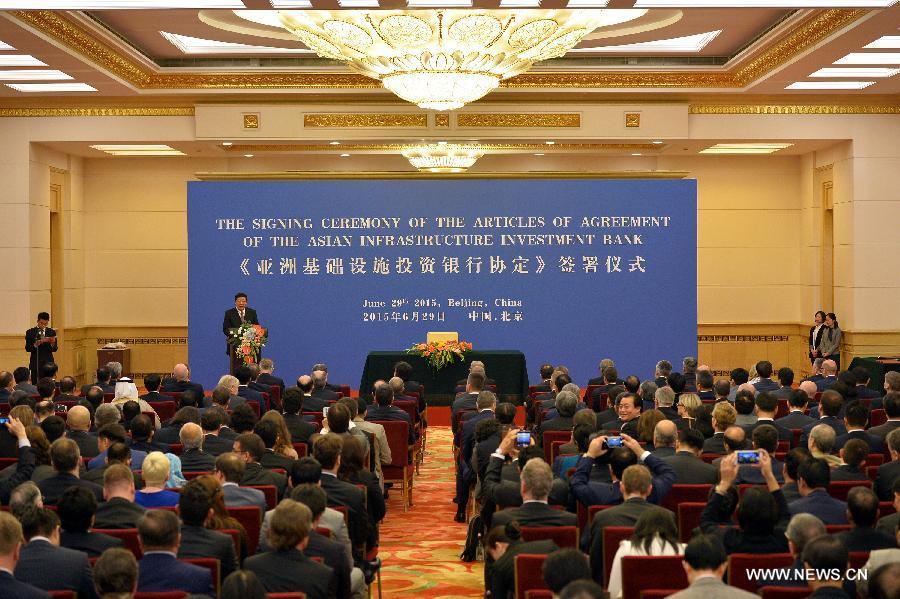Cérémonie pour la signature de l'accord fixant le cadre juridique de la BAII